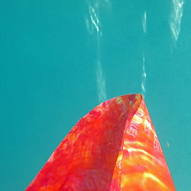 """""""Underwater,"""" 2014, underwater photo of a floating painting, printed on aluminum in limited edition prints, 12 x 12 in."""