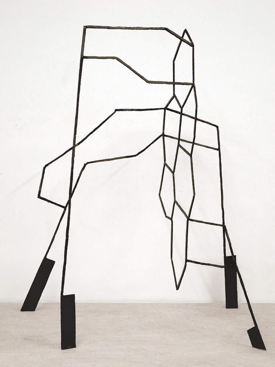 Right: Dominique Labauvie, Honeycomb, 2014, Forged steel, 53 x 43.5 x 32 in.