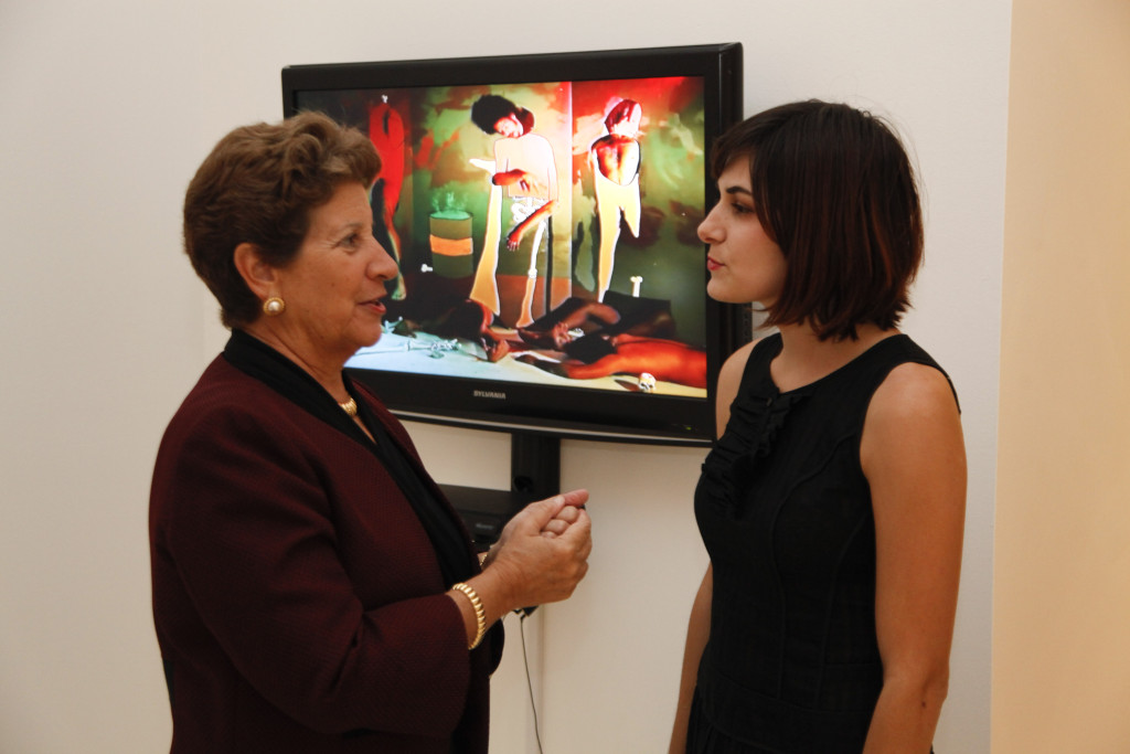 2012 Fellowship Winner in Visual Arts, Jillian Mayer, discussing her work with CINTAS Foundation President, Hortensia Sampedro, at the Finalists Exhibition and Awards Announcement.
