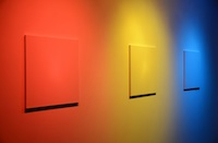Matthew Deleget, Color Vulture - Detail, 2012, 3 off the shelf white canvases, red, yellow, and blue spotlights, Dimensions variable, canvases 24 x 20 in. each. Courtesy of Alejandra von Hartz GalleryMatthew Deleget has drawn acclaim for merging rectangular forms, architectural space, and color. ET